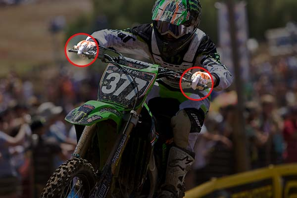 In this image, you can see Pourcel getting ready for the upcoming turn by positioning both his middle fingers on the levers, and getting ready to brake into the turn.